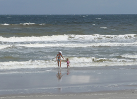 Woman and child at shore line.jpg